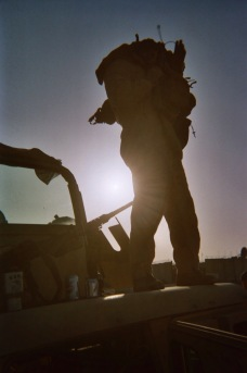 A Marine gets ready for patrol. Anbar Province, Winter 2007.